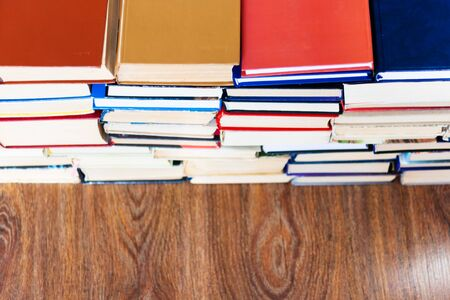 stack of old book on wooden table, education concept background, many books piles with copy space for text