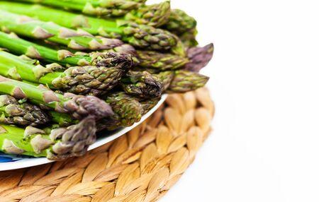 Bunch of fresh raw asparagus on white background, vegetarian concept. Green grass sparrowgrass sticks, food for veggie