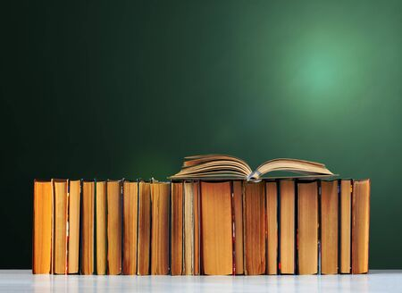 Back to school, pile of books with empty green school board background, education concept 版權商用圖片