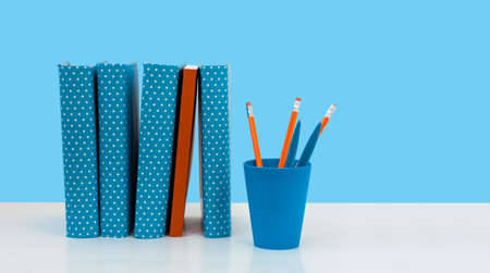 Back to school, pile of books with blue background. Distance home education. Quarantine concept of stay home