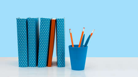 Back to school, pile of books with empty blue background. Distance home education. Quarantine concept of stay home Stock fotó