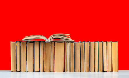 Back to school, pile of books with red background. Distance home education. Quarantine concept of stay home