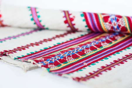 A stack of woven linen towels with embroidery, traditional handmade in Ukraine. 스톡 콘텐츠