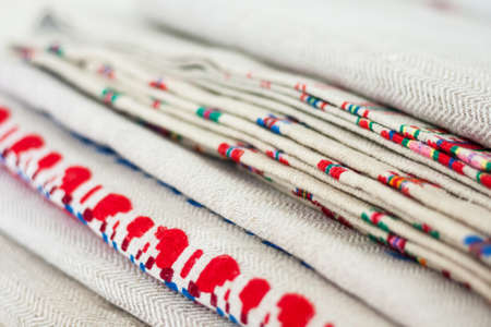 A stack of woven linen towels with embroidery, traditional handmade in Ukraine. Stockfoto
