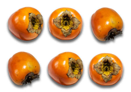 Fresh ripe whole persimmon, sharon on white background with copy space for text, healthy vegetarian diet top view