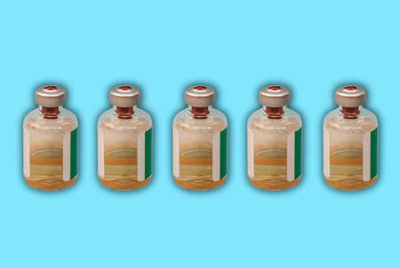 Medicine bottles with injection fluid with aluminum caps,  virus vaccine on blue background.  epidemic, Cancer, painand diabetes treatment, pharmaceutical medicine concept