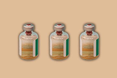 Medicine bottles with injection fluid with aluminum caps, coronavirus vaccine on orange background. Covid epidemic, Cancer, painand diabetes treatment, pharmaceutical medicine concept