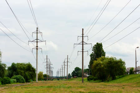 High-voltage DC line in a city park near the lake, Kiev, Ukraine
