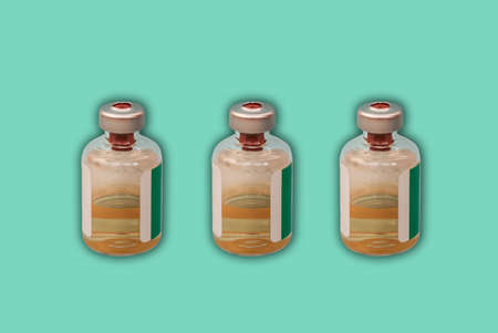 Medicine bottles with injection fluid with aluminum caps, vaccine on green background. epidemic, Cancer, pain and diabetes treatment, pharmaceutical medicine concept