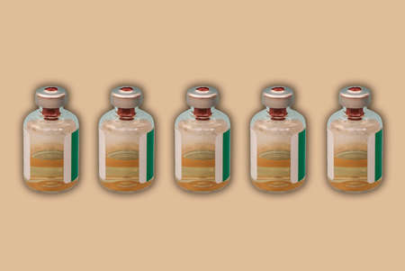 Medicine bottles with injection fluid with aluminum caps,  vaccine on orange background. epidemic, Cancer, pain and diabetes treatment, pharmaceutical medicine concept