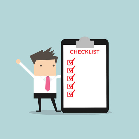 Businessman completing a checklist ticking al the boxes