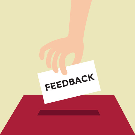 customer feedback: Hand putting Feedback paper in the box.