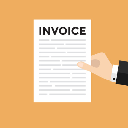 Hand holding a letter with Invoice headline