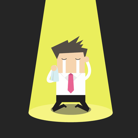 heartbreak issues: Unlucky businessman crying alone in spotlight