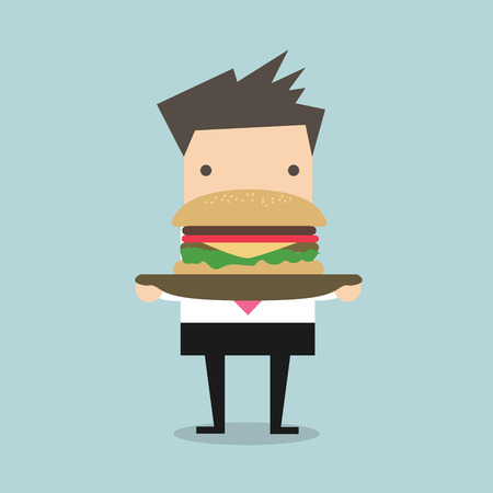 trimmings: Businessman carrying a big hamburger with a beef patty and trimmings