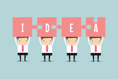 coordinating: Businessmen with jigsaw pieces with the word idea