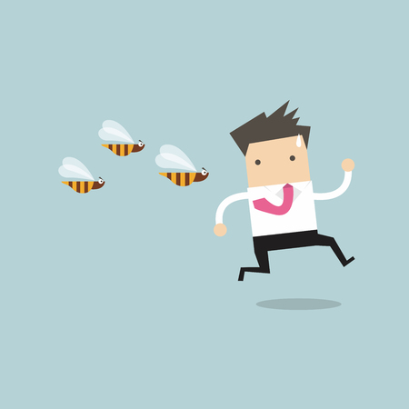 Businessman running away from dangerous insects