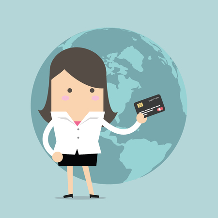 businesswoman standing: Businesswoman standing holding his a credit card in front of the globe