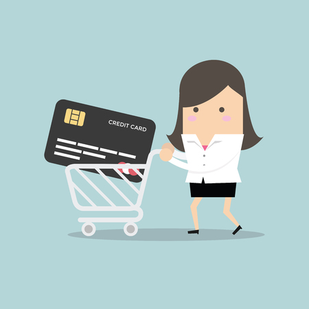 Businesswoman with credit card in shopping cart