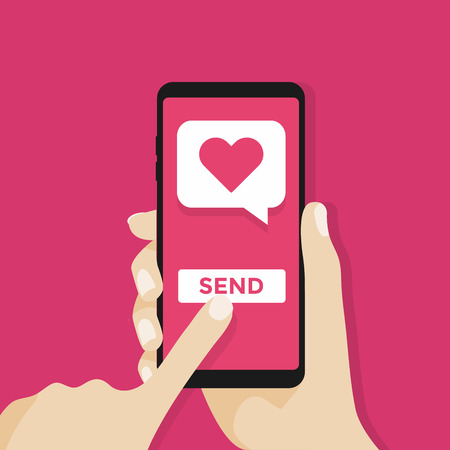 Sending love message. Hand holding phone with heart bubble, send button on the screen.