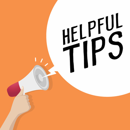 Hand holding loudspeaker or megaphone with speech bubble HELPFUL TIPS. announcement concept. vector  イラスト・ベクター素材