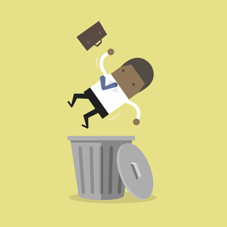 African businessman dropped into trashcan layoff concept.