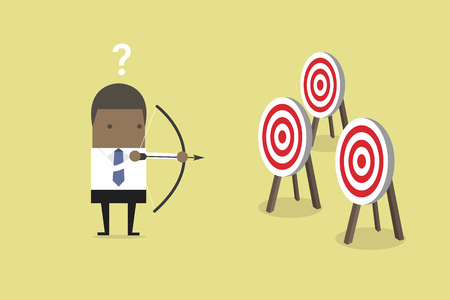 African businessman holding bow and arrow confused by multiple bulls eye target. Vettoriali