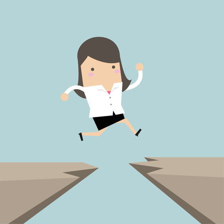 Businesswoman jump through the gap from one cliff to another.