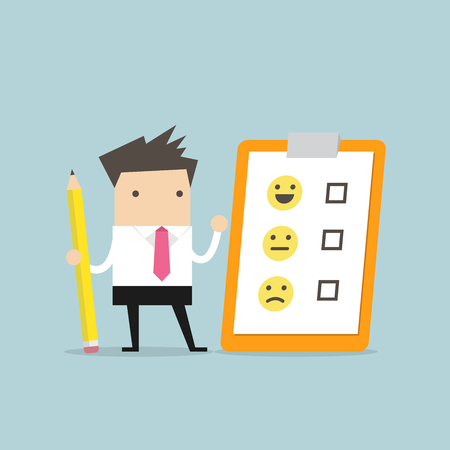Businessman holding pencil and paper of checklist feedback on clipboard. Customer Evaluation. Feedback Emoticons. Reklamní fotografie - 117233034