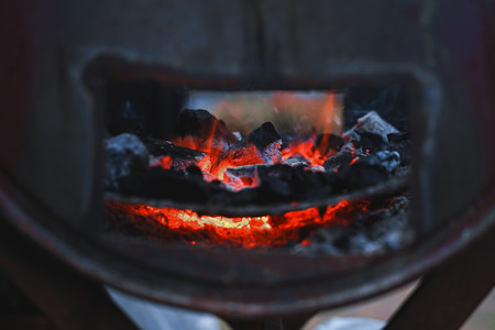 Close up fire charcoal in stove for cooking and grilling food or barbecue. Imagens