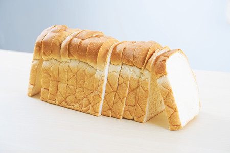 Homemade slide bread on the wooden table. Stock Photo