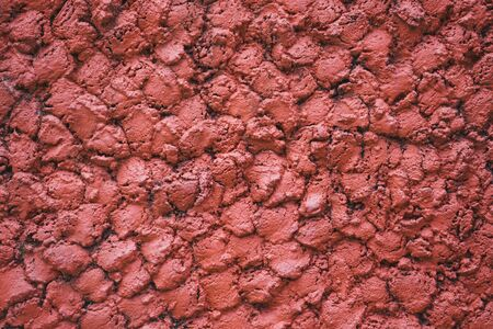 Abstract concrete red wall textures background. Background of a red stucco coated and painted exterior.