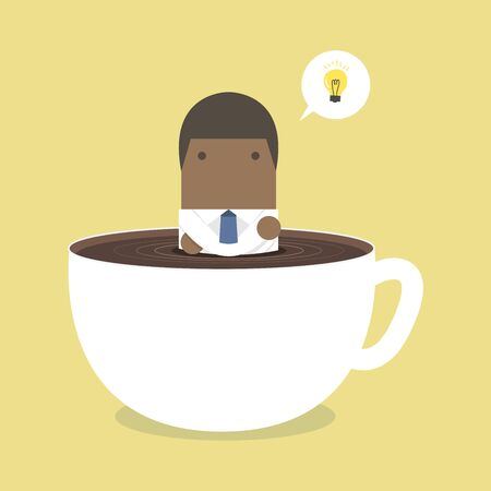 African businessman thinking in a coffee cup.