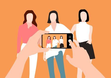 The hands of a man taking group of woman photos with a smart phone and showing the photo in the screen.