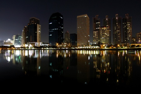 Central business district looking from lake at night, Bangkok Thailand. photo