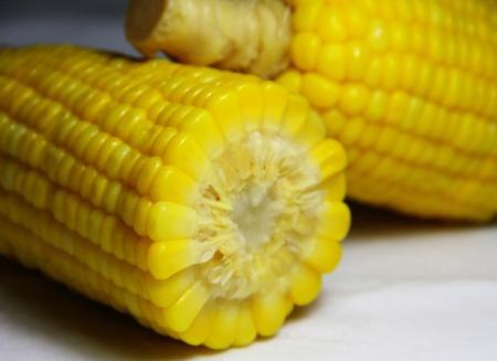 crosscut: yellow corn that crosscut on white floor