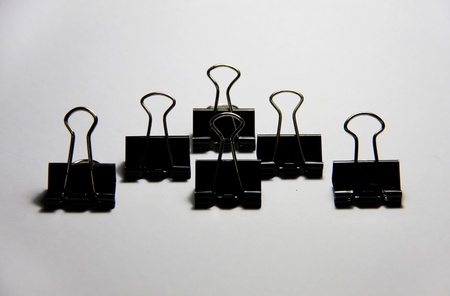 binder clips are arranged on white paper Stock Photo - 13261057