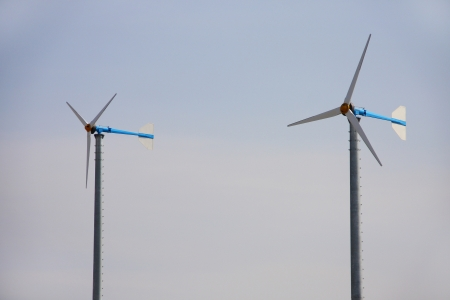 generate: windmill for  generate power  in rural of Thailand, clean technology Stock Photo