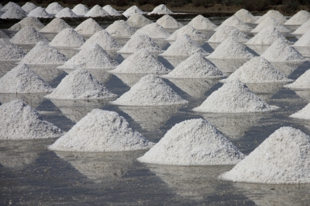 pan tropical: pile of salt in the salt pan at rural area of Thailand Stock Photo