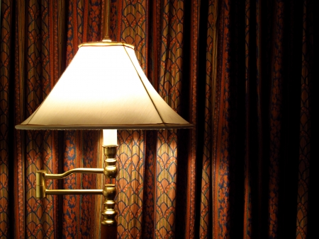 stand lamp and red curtain in the room photo