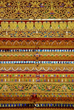 pattern in Thais style made from colorful glass in temple.Thailand photo