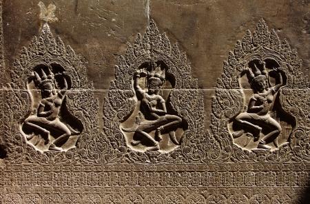 Apsaras - khmer stone carving in Angkor Wat, Cambodia photo