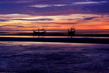 wooden boats on the beach at sunrise, gulf of Thailand  photo