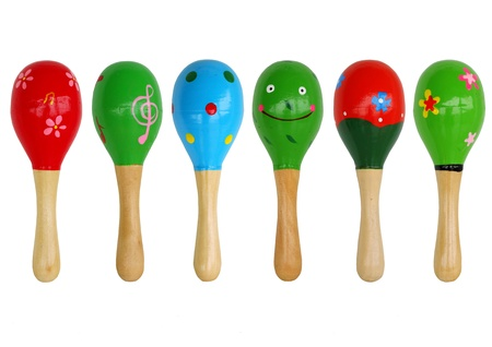 isolated maracas are  arranged on white background, musicial instrument. photo