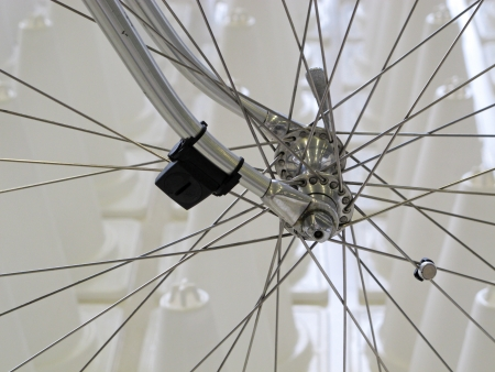 speed and distance measure equipment on bicycle wheel.