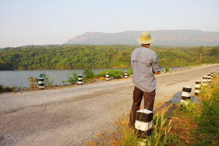 Man standing on the dam, irrigation in central of Thailand. Stock Photo - 17891906