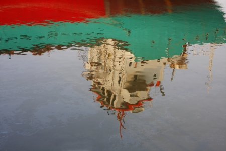 slick: Pollution, reflection of merchantman and oil slick.