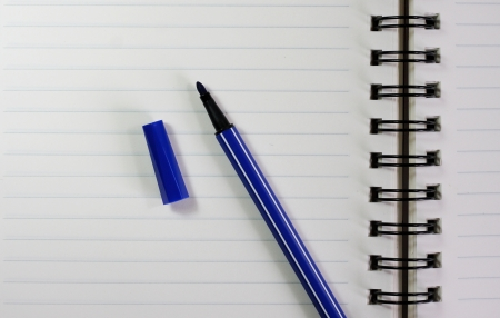 Notebook and blue color pen. photo