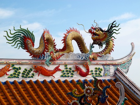 kunming: Dragon statue on the roof of Chinese temple. Stock Photo