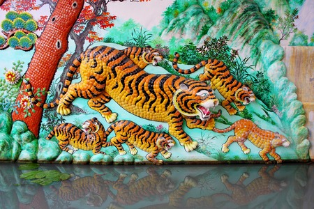 Bas Relief (tigers) in Naja Shrine, Chinese temple at Angsila, Chonburi, Thailand. photo